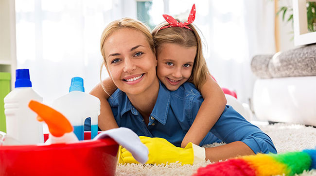 Happy family house cleaning using eco-friendly cleaning products